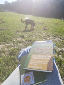 Enjoying some quiet watering and reading time with my dog.